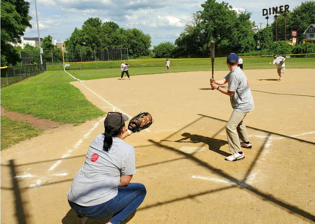 Staff playing baseball